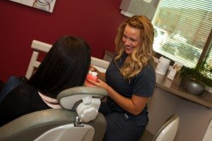 Dental assistant with patient, cosmetic dentist Franklin, TN, best dentist for zoom! in-office whitening teeth whitening.