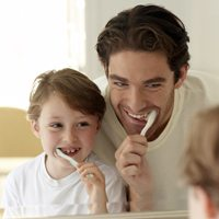 Family brushing teeth, Franklin, TN dentist office, the best family dentist and teeth whitening and zoom! in-office whitening.